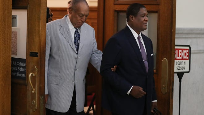"Bill Cosby, left, is led out of Courtroom A on the Montgomery County Courthouse after his pretrial conference was ended on Sept. 6, 2016 in Norristown, Penn. Prosecutors preparing for his sexual-assault trial hope to call 13 of about 60 accusers to show he drugged and molested young women as part of a ""signature"" crime spree spanning five decades."