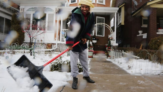 Carrie Hicks, is originally from Sanford, Fla., but for the past 60 years she has called the east side of Detroit home. She is clearing the walkway and sidewalks in Feb. 2016.