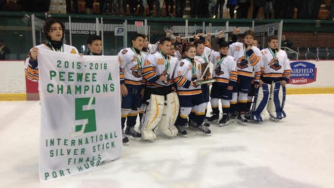 The NobleKing Knights pose with their championship banner after a 1-0 win over Uxbridge Stars.