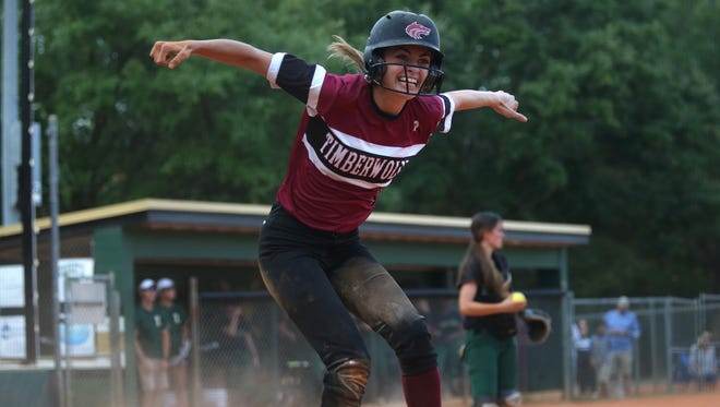 Chiles' Maegan Tomlinson celebrates after scoring a run against Lincoln in the District 2-8A championship game, which the Timberwolves won 1-0 at Lincoln High School Thursday, April 27, 2017.