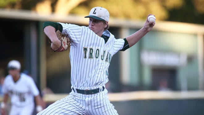 Lincoln's Austin Pollock pitches a complete game shutout of Wharton in the Trojans 2-0 Region 1-8A final win on Friday.