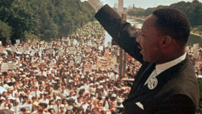 "Dr. Martin Luther King Jr. acknowledges the crowd at the Lincoln Memorial for his ""I Have a Dream"" speech during the March on Washington, D.C. Aug. 28, 1963."