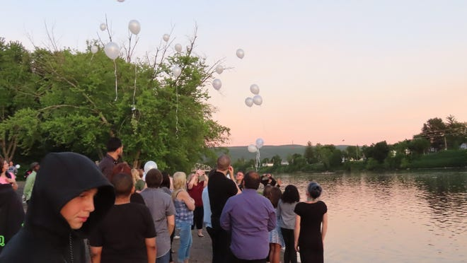 Dozens of white balloons were released during a lantern memorial ceremony held at West End Beach in Port Jervis on Monday for young Tyler Cosentino.