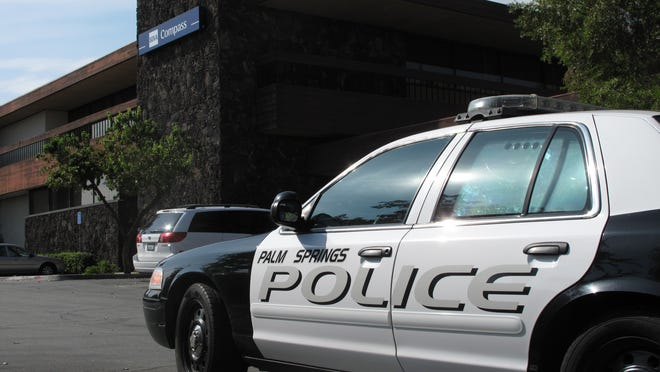 A Palm Springs police car sits outside BBVA Compass bank, 420 S. Palm Canyon Drive, as officers talked with witnesses inside after a report of a robbery on Friday, Oct. 22, 2010. (Brian Indrelunas, The Desert Sun)