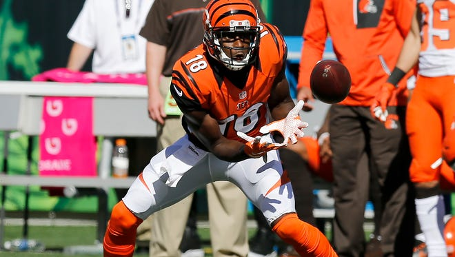 Cincinnati Bengals wide receiver A.J. Green (18) makes a catch in the second quarter of the NFL Week 7 game between the Cincinnati Bengals and the Cleveland Browns at Paul Brown Stadium in Cincinnati on Sunday, Oct. 23, 2016. At halftime the Bengals led the Browns 21-10.