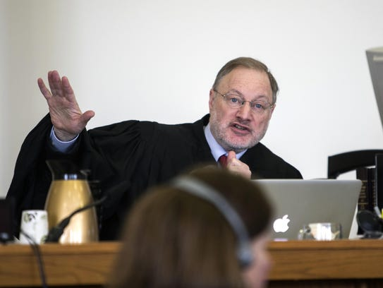 Judge Larry M. Smukler makes a ruling during the first