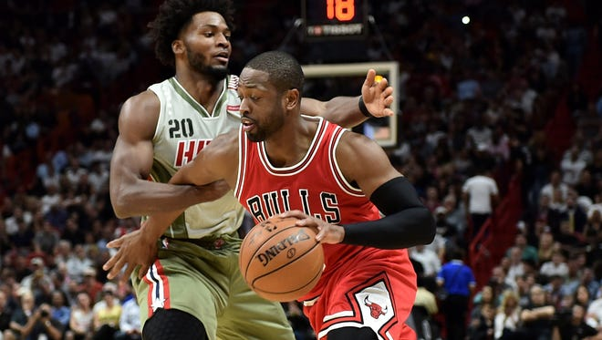 Dwyane Wade (3) drives against Justise Winslow (20).