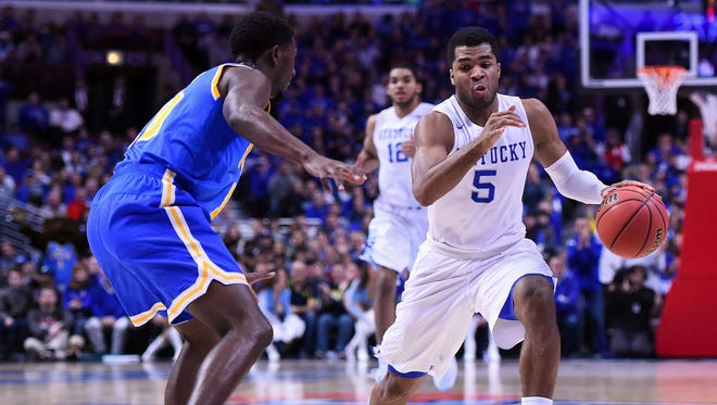 Kentucky guard Andrew Harrison (5) dribbles the ball against UCLA during the Wildcats' blowout win in Chicago.