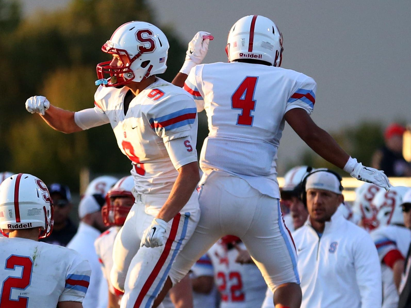 South Salem's Gibson Hohberg (9) and Tony Phong (4) celebrate Hohberg's touchdown in the first half of the South Salem vs. McKay football game at McKay High School in Salem on Friday, Sept. 4, 2015. South Salem leads 26-7 at the half.