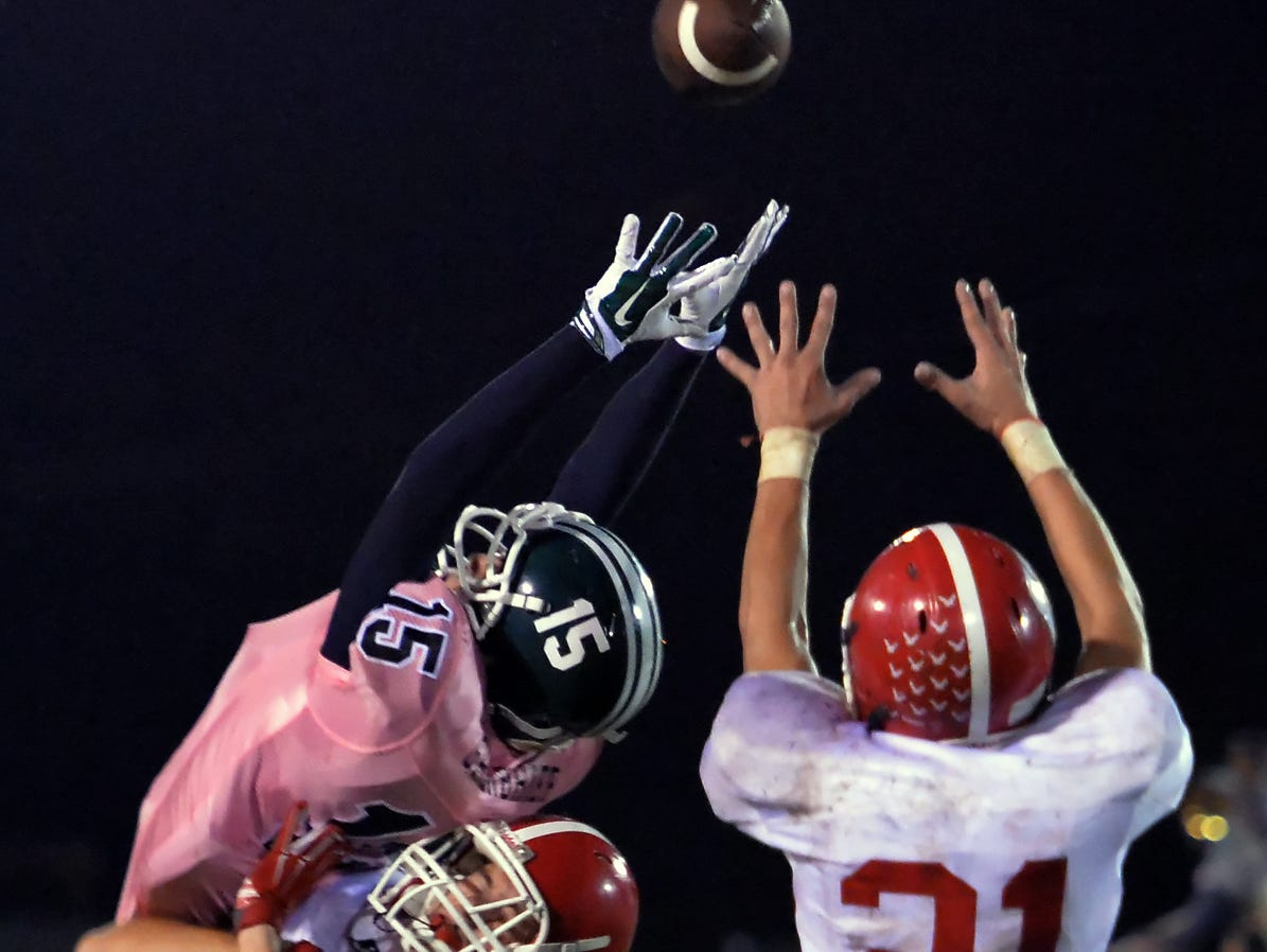 Westmoreland's Jake Perry (21) intercepts a pass over the outstretched arms of Greenbrier's Barry Blankenship (15) in the first half Friday.