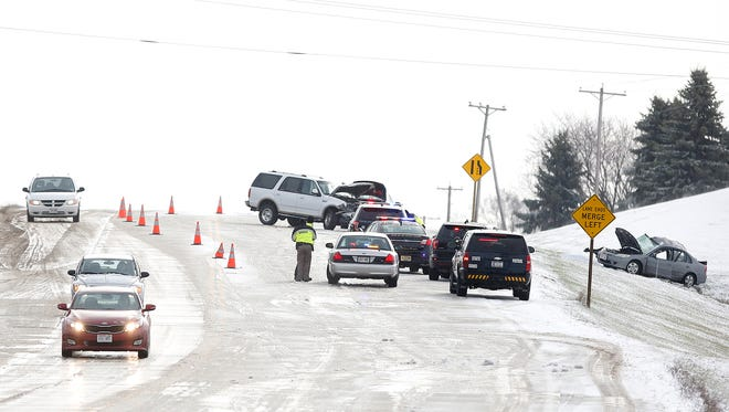 Emergency crews investigate a vehicle crash on Highway 23 east of Fond du lac Thursday. One person died in the crash.