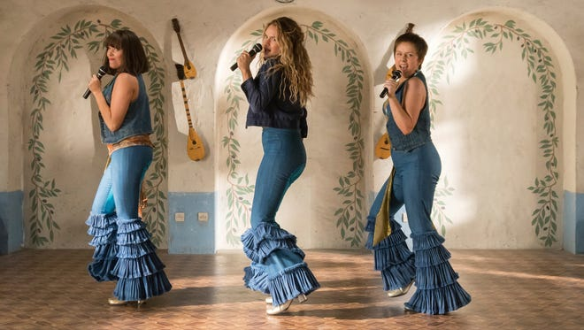"This image released by Universal Pictures shows, from left, Jessica Keenan Wynn, Lily James and Alexa Davies in a scene from ""Mamma Mia! Here We Go Again."""