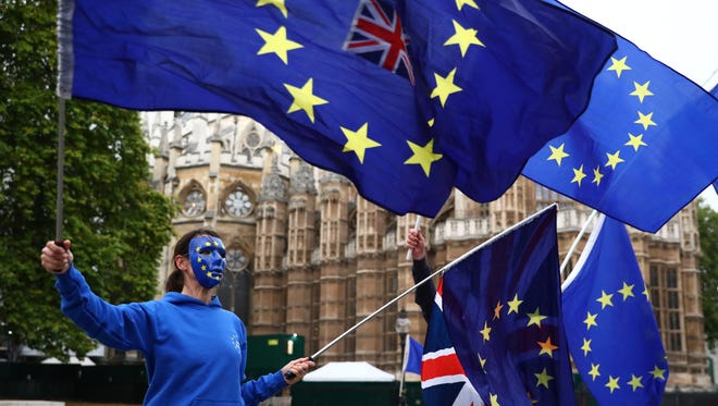 Pro-EU campaigners protest outside the Houses of Parliament in London on Oct. 17, 2017.