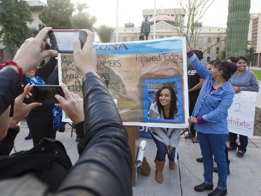 Erika Andiola poses in a poster of an Arizona driver's license on Dec 17, 2014.