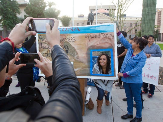 Erika Andiola gets her portrait taken during celebrations at the Arizona State Capitol in 2014 after Dreamers win a court battle to get driver's licenses.