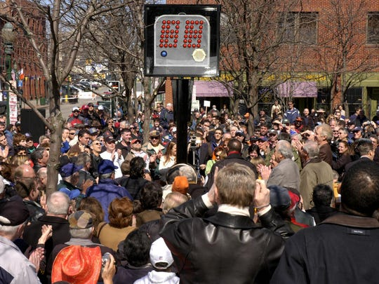 Several hundred people attended the unveiling of a monument commemorating the 24-second shot clock in Syracuse on March 26, 2005.