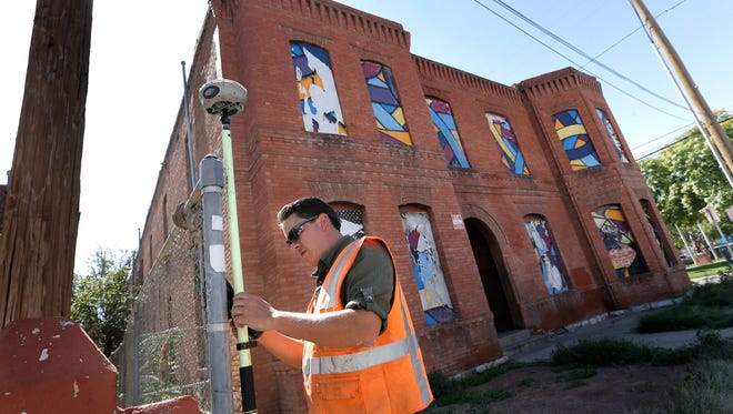 Surveyors on Friday were charting the area around The Mansion building at 306 W. Overland Ave., inside the proposed Downtown footprint for a $180 million multipurpose arena project. The 115-year-old Mansion building is El Paso's last-standing former brothel, according to local building historians.