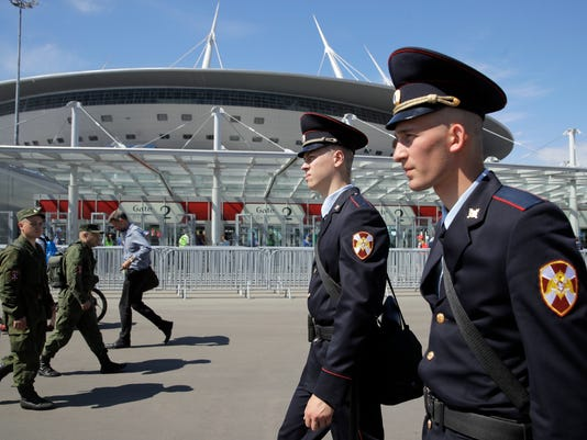Police officers patrol prior to the Confederations Cup, Group A soccer match between Russia and New Zealand, at the St. Petersburg Stadium, Russia, Saturday, June 17, 2017. (AP Photo/Pavel Golovkin)