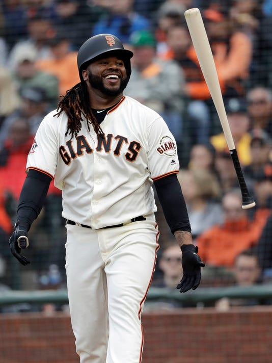 San Francisco Giants' Johnny Cueto smiles as he strikes out against the Seattle Mariners during the fifth inning of a baseball game Wednesday, April 4, 2018, in San Francisco. (AP Photo/Marcio Jose Sanchez)