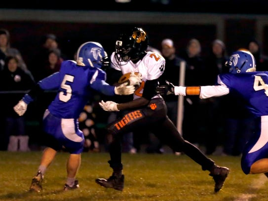 Stratford running back Teddy Redman runs past opponents to score a touchdown during the Division 5 state quarterfinal football game between Amherst and the Tigers on Friday night.