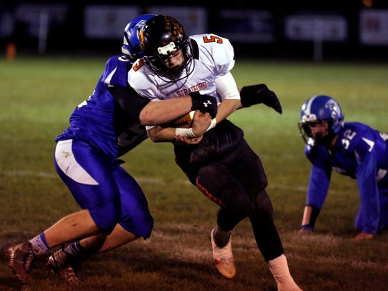 Zach Toelle and the rest of the Amherst defense will have their hands full with University of Wisconsin commits John and Leo Chenal of Grantsburg in their Division 5 state semifinal matchup Friday night in Stanley.