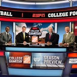 Rece Davis, second from left, is the new host of ESPN College GameDay and teaming with returning analysts (L-R) Desmond Howard, Lee Corso and Kirk Herbstreit