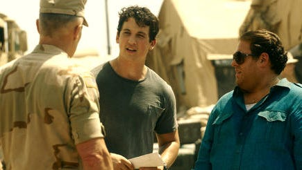 "This image released by Warner Bros. Pictures shows Miles Teller, left, and Jonah Hill in a scene from, ""War Dogs."""