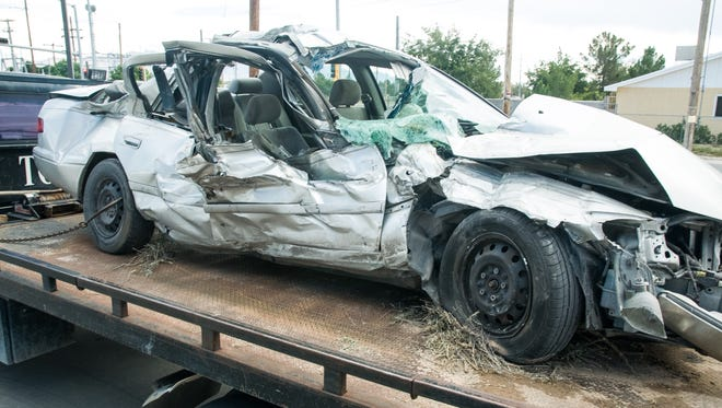 A car is loaded onto a tow truck after it was struck by a train on Monday at O'Hara Road and Highway 478 in Anthony, New Mexico. The extent of injuries are unknown.