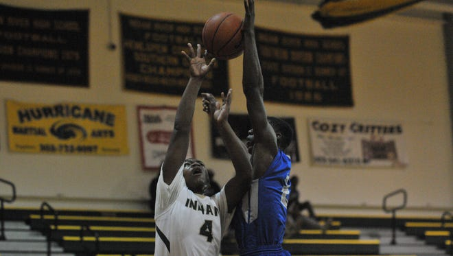 Indian River's freshman guard Jamier Felton is fouled by a Woodbridge player during a loss on Tuesday, Dec. 15. Felton led the Indians with 15 points in the 71-52 loss.