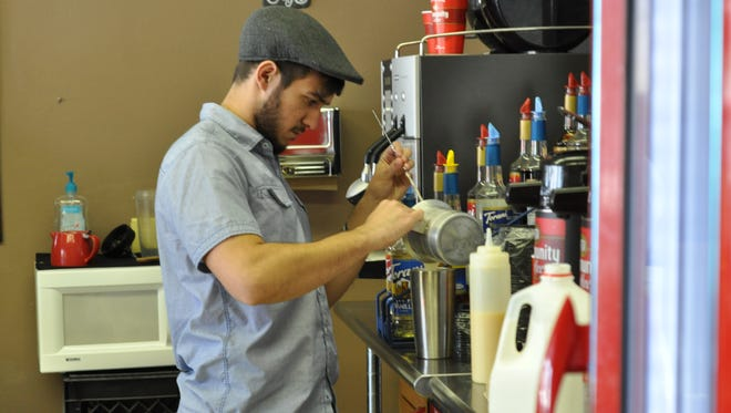 Louisiana College junior Chris Verzwyvelt, 20, is the new owner of Hidden Grounds in Pineville, formerly known as The Coffee Shop.