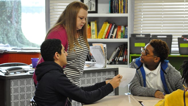 Christal Varholdt is shown with her seventh-grade ELA students at Alexandria Middle Magnet School.