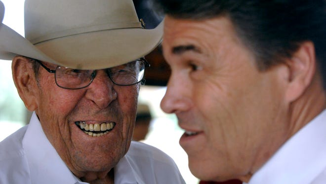 Ray Perry, seen here laughing with his son, then-Governor Rick Perry, at an Abilene campaign event in 2010 at Frontier Texas!, died Thursday.