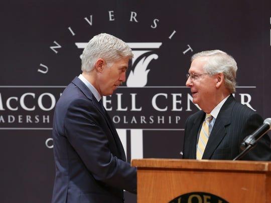 Senator Mitch McConnell, right, greeted Supreme Court