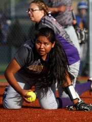 Kirtland Central's Shiloh Lewis fields an infield hit