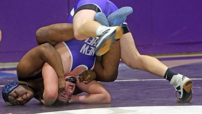 Tyrell Jackson of Suffern defeated Aiden Lilly of New Rochelle 2-1 in overtime in a 220 pound bout during a wrestling meet at New Rochelle High School Jan. 7, 2016.