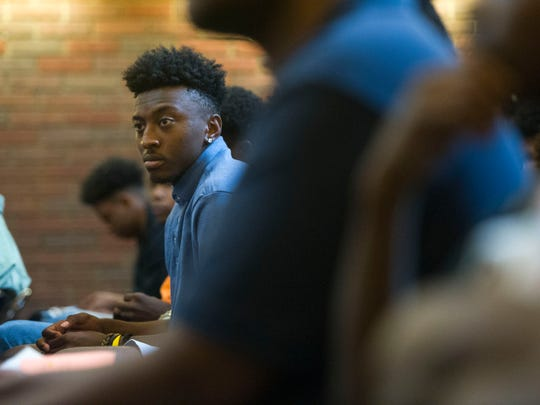 An attendee waits to hear keynote speaker Chris Blue, winner of NBC's 'The Voice' season 12, at the Save our Sons Summit II at Pellissippi State Community College's Magnolia campus on Friday, June 30, 2017. Save Our Sons works with the community to address  gaps in opportunity and to end violence-related deaths among boys and young men of color.