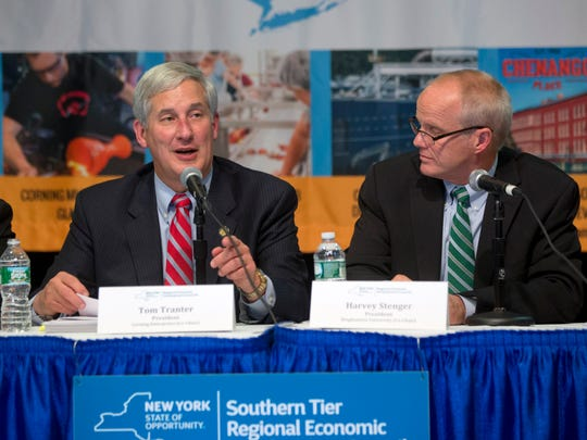 Tom Tranter of Corning Enterprises, left, speaks during a Regional Economical Development Councils hearing as Harvey Stenger, president of Binghamton University, listens on Oct. 20, 2015, in Albany.