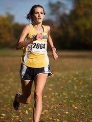 Newark senior Rachel Beston crosses the finish line
