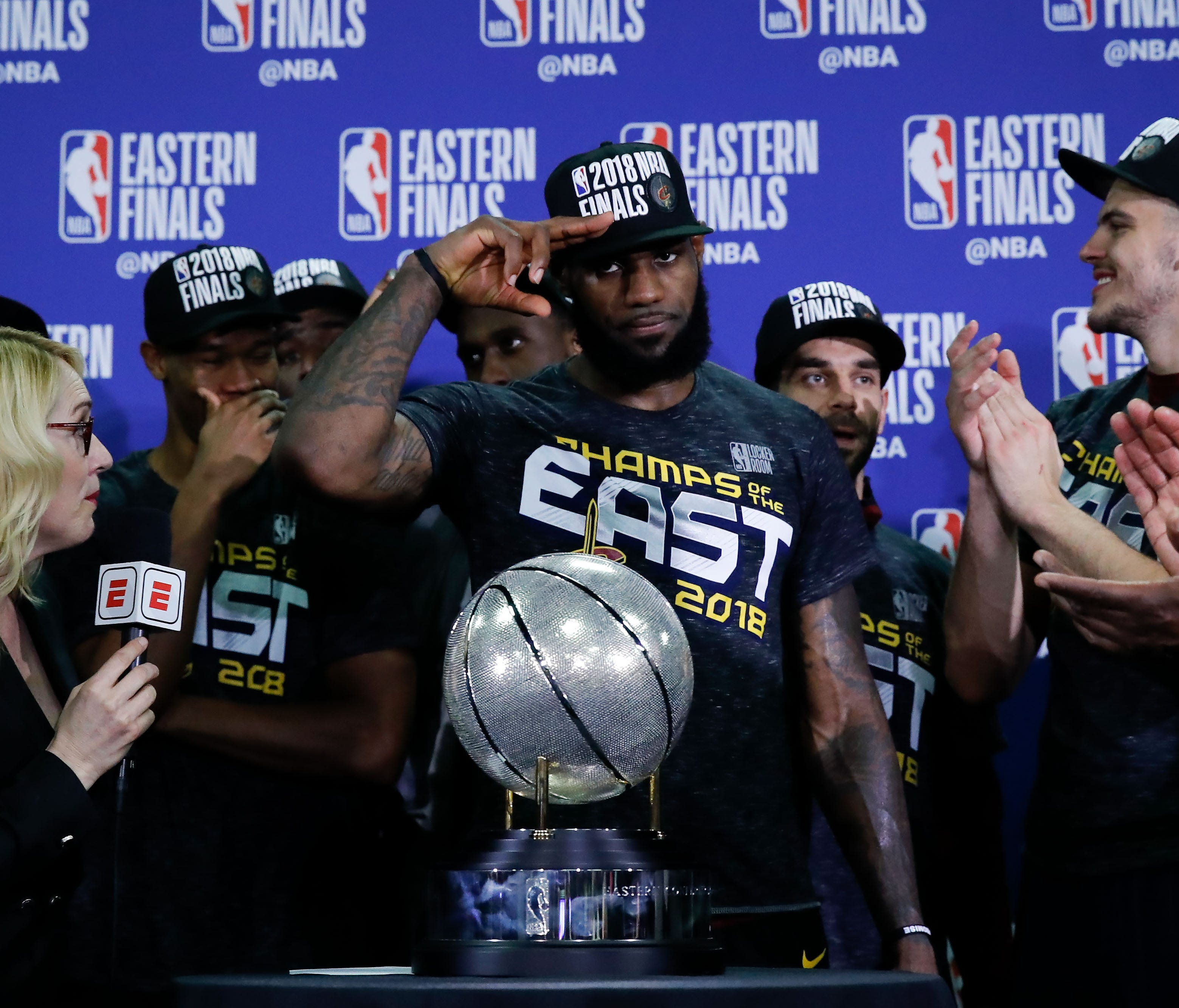 Cleveland Cavaliers forward LeBron James solutes in front of the Eastern Conference trophy after defeating the Boston Celtics in the 2018 NBA Playoffs at TD Garden.
