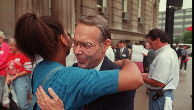 Frank Simon, right, is seen in 1997 hugging a supporter outside of Louisville city hall. Simon was an opponent to the Fairness ordinance