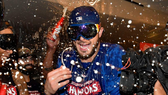 Kris Bryant celebrates with teammates after the Cubs won the NL Central division.