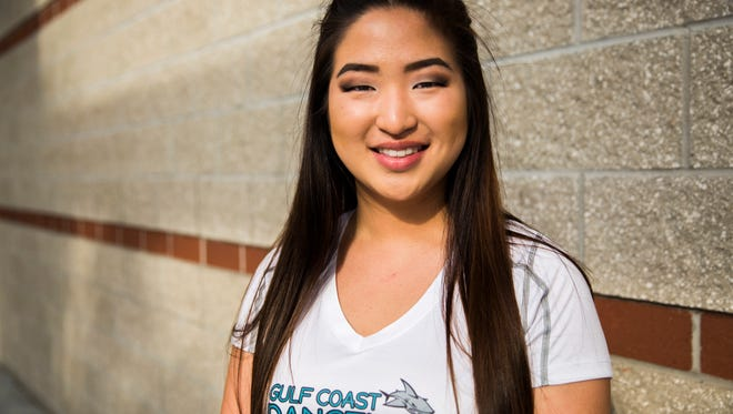 Elaine Kim poses for a portrait before the start of her Dance Line practice at Gulf Coast High School on Thursday, May 10, 2018. Kim will attend Brown University in the fall and pursue a degree in biology.