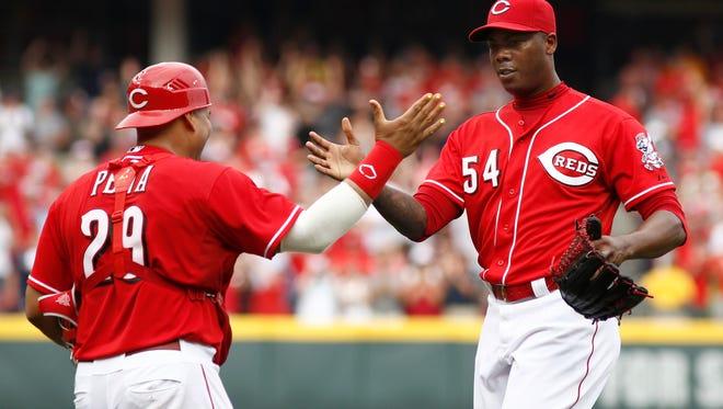 Cincinnati Reds pitcher Aroldis Chapman (54) is congratulated by catcher Brayan Pena (29).