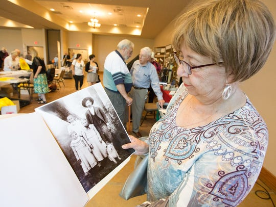 Olivia Lerma-McDonald shows off a picture of her grandmother,