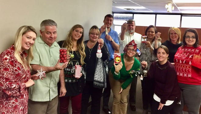 Accurate Mortgage Group employees enjoy a Christmas ornament swap in 2016.