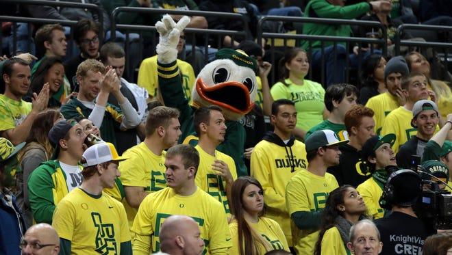 Oregon Ducks mascot celebrates with fans at Matthew Knight Arena.
