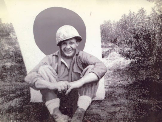 Junior Howell with Japanese flag during World War II.