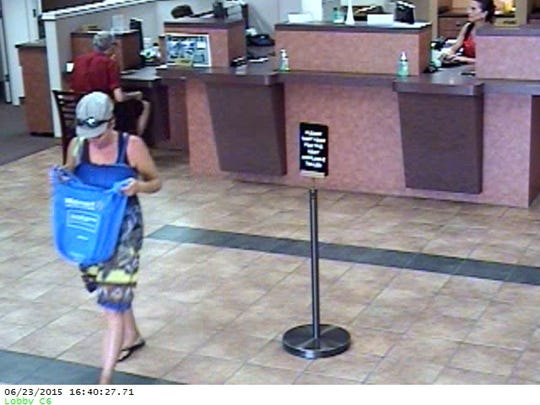 The woman was last seen wearing a yellow and blue sundress while running from the bank in Mesa, officials said.