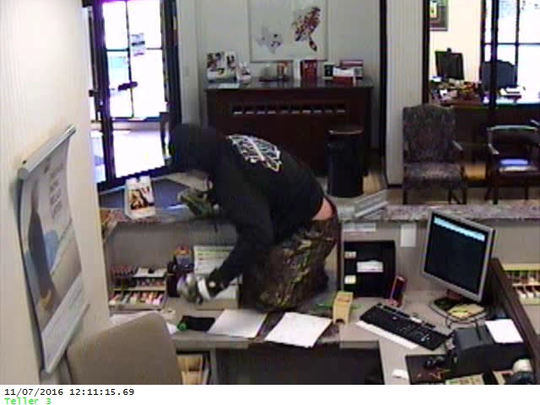 This series of photos released by police show a man wanted in a Monday robbery of BB&T Bank in Tallassee.