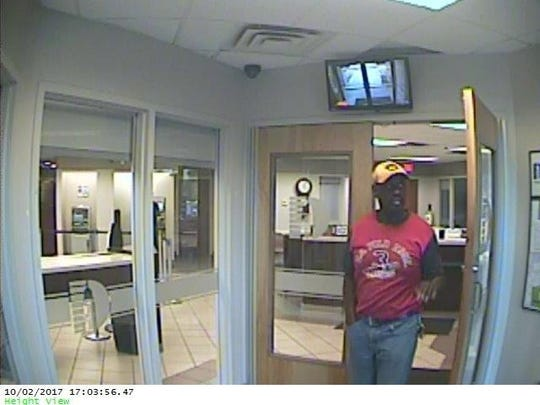 Police say this man accompanied the woman while she used a stolen credit card.